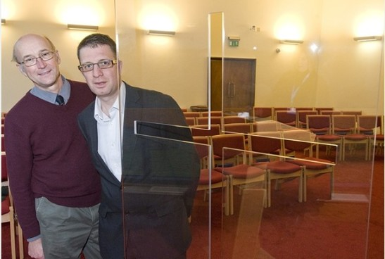 Council leader Paul Crossley and Cllr David Dixon pose with the new mobile cross. (Photo: Bath Chronicle)