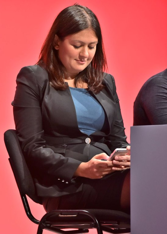 Lisa Nandy, the new Shadow Secretary for Energy and Climate Change, checks her phone during Labour's very civil conference. (Source: Rex Features)